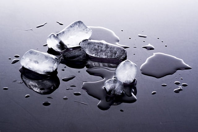 Melting ice cubes scattered on a table